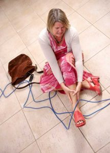 Woman clutching ankle after falling