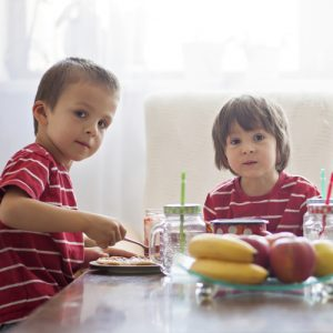 Kids eating a healthy breakfast in the morning