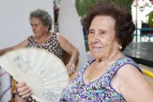 Image of diabetes patient fanning herself on hot day