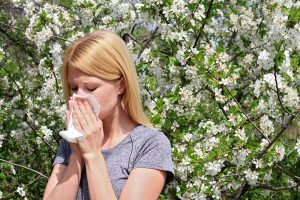 image of woman with pollen-allergy symptoms