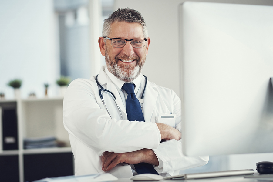 image of physician reviewer doing chart reviews