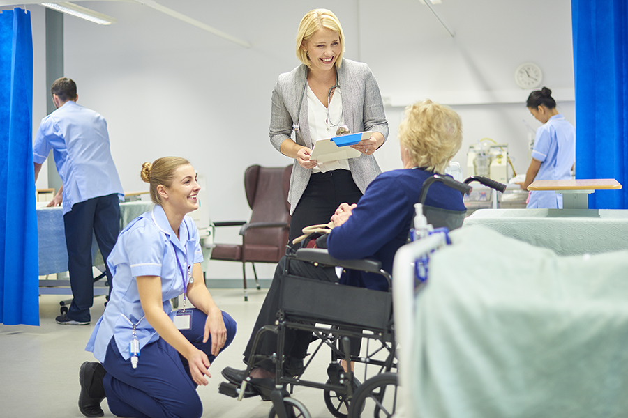 image of patient talking with hospital employees about being discharged