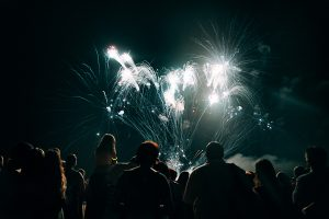 image of a crowd watching a professional fireworks display - AFMC