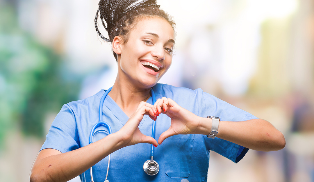 Nurse makig heart symbol with hands
